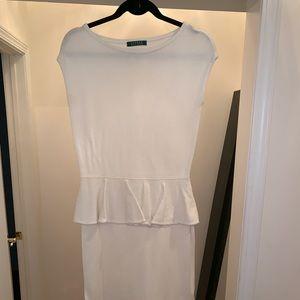 Cream sleeveless peplum knee length dress.